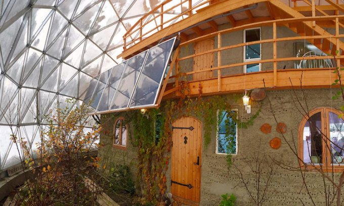 House and garden inside a greenhouse geodesic dome