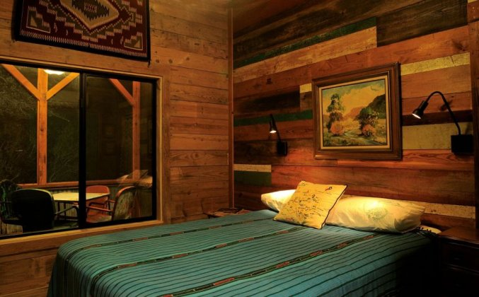 Cabin bedroom made from reclaimed wood