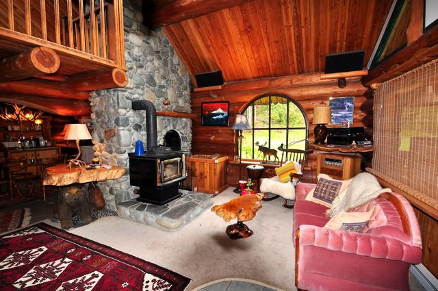 Log cabin with rustic frontier feel inside