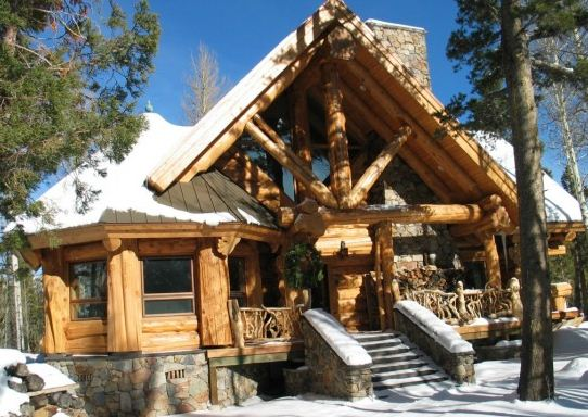 Mountain log cabin in the winter