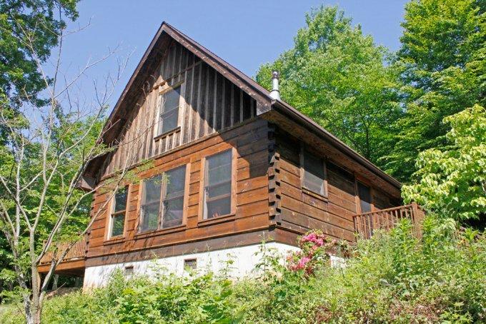 Peaceful rustic log cabin back view
