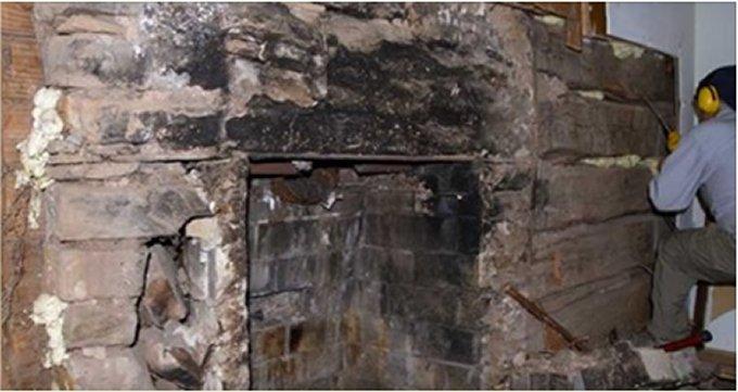 Log cabin behind walls