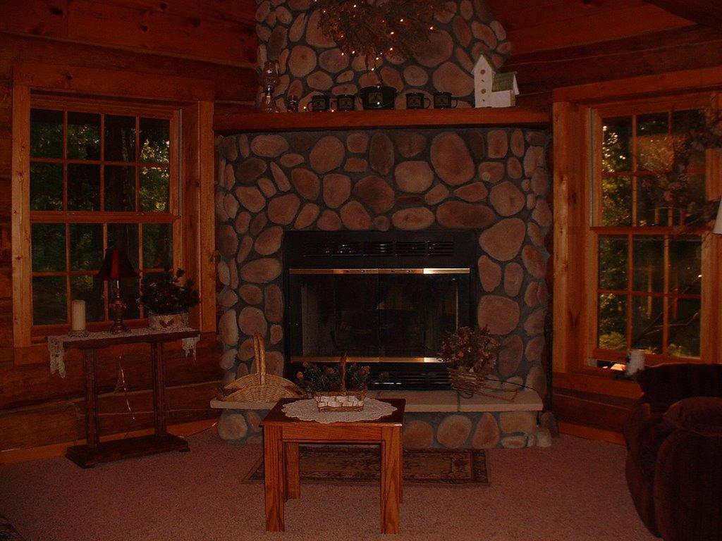 Woodland log cabin fireplace