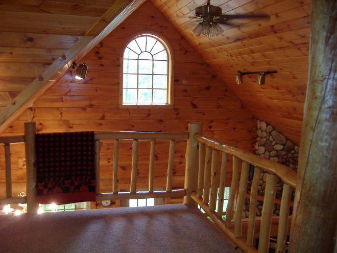 Woodland log cabin loft