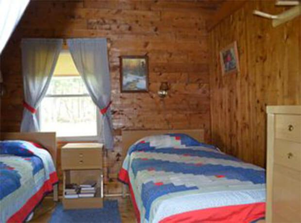 Lakeside log cabin bedroom