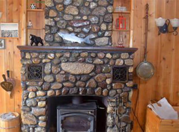 Lakeside log cabin fireplace