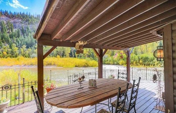 Riverside log cabin porch