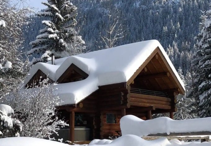 Mountain log cabin in winter